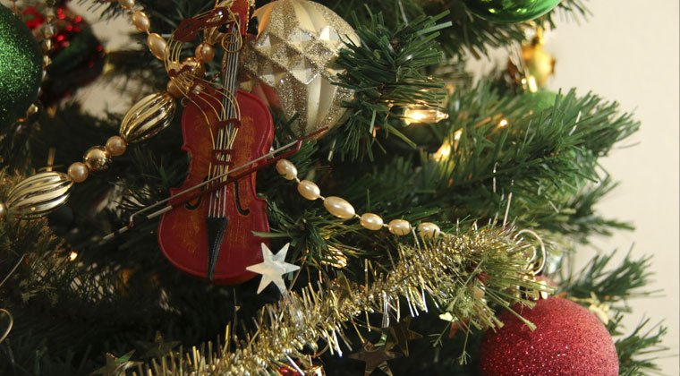 Miniature cello hanging on a Christmas tree and 12 cello songs for the holiday