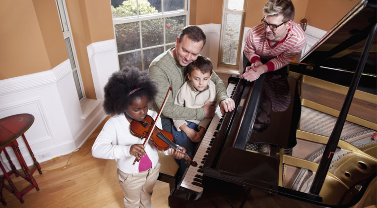 A violin student performing in front of her teacher and her father who advocates for her musical development
