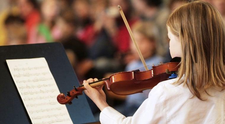 young beginner violin string musician reading music
