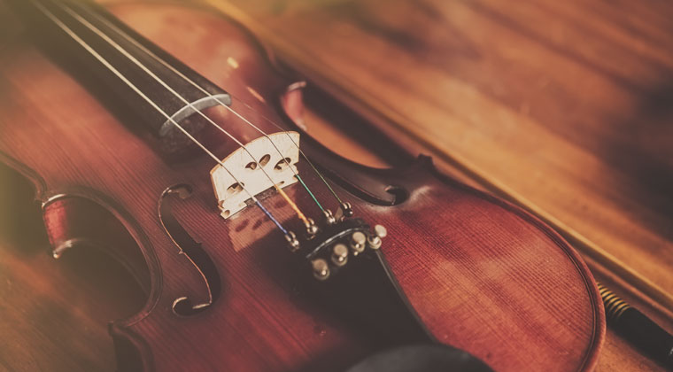 Violin laying on wooden table