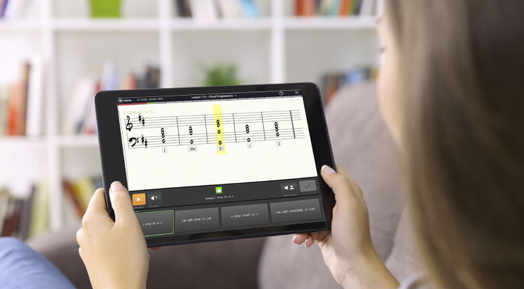 girl on tablet using app to learn the violin