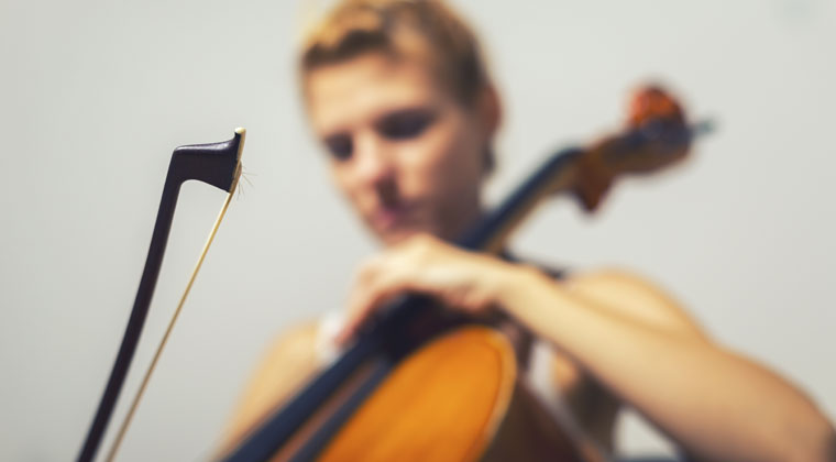 young woman practicing cello