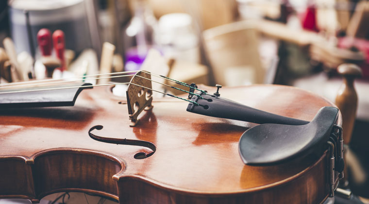 A violin in need of repair using your in-case first-aid kit.