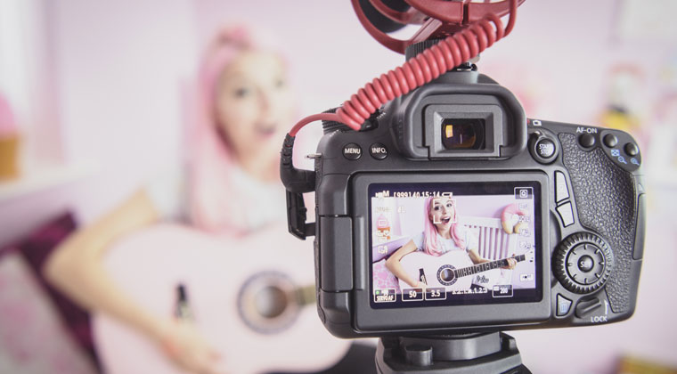 string performer shooting her own video while keeping social media dos and don'ts in mind to build a positive online presence