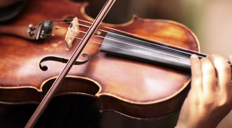 Close-up of violin being played to create great sound