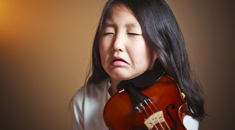 young violinist upset by losing competition