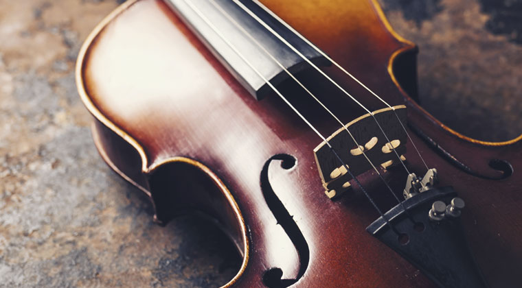 close up of violin strings and how often you should change them