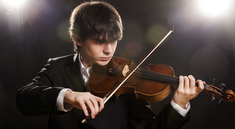 young violinist playing using his chin rest