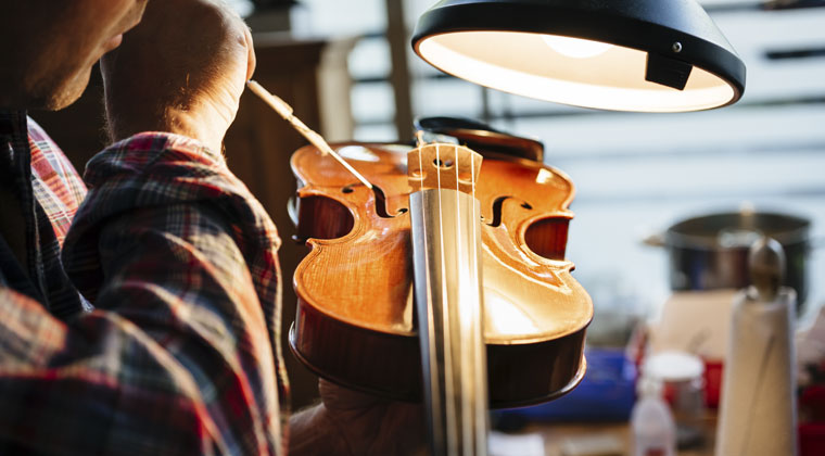 luthier fixing a violin