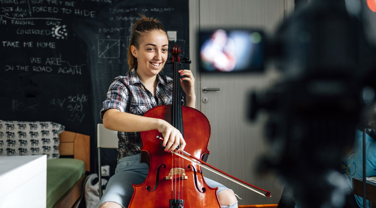 young girl taping her performance at home on the cello without violating copyright law