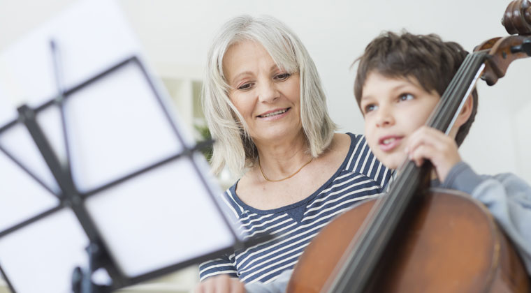 music teacher and cello student teaching private practice