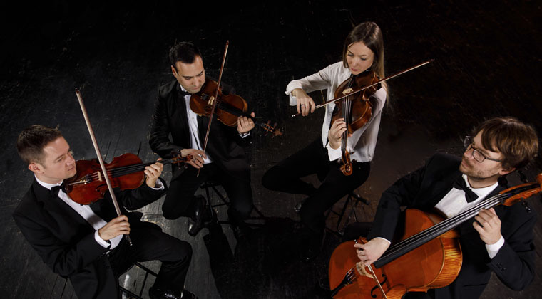 string quartet practicing as a group