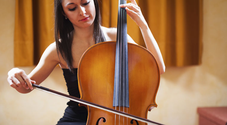 young girl in music school practicing cello