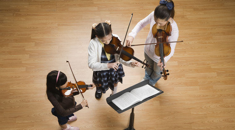 children playing violins that are the right size for them