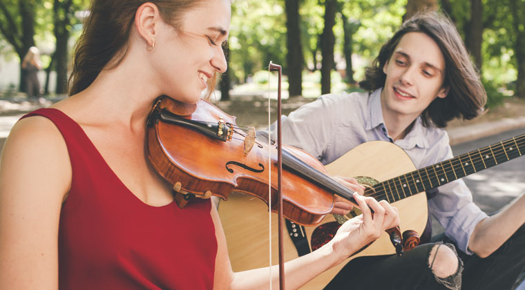 staying in tune by playing violin with friend during the summer vacation