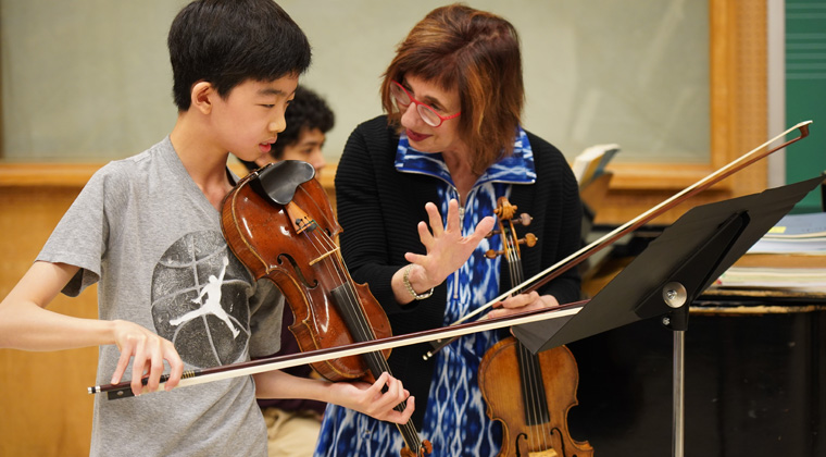 Mimi Zweig teaching a student
