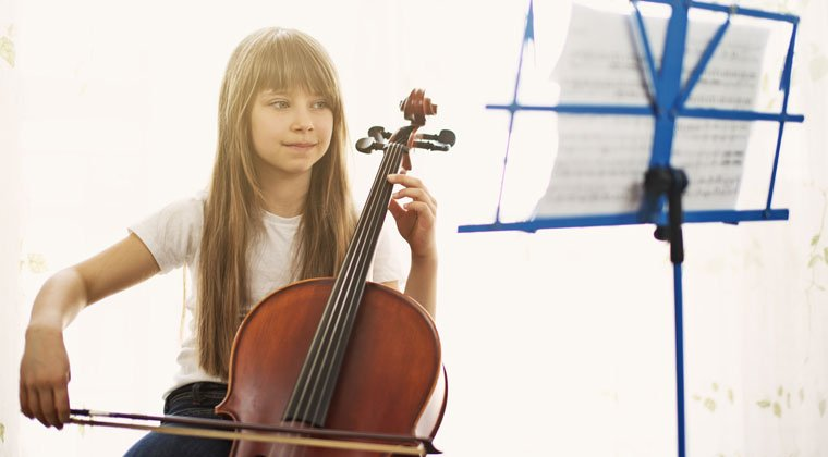 young celloist playing popular songs for her friends and family