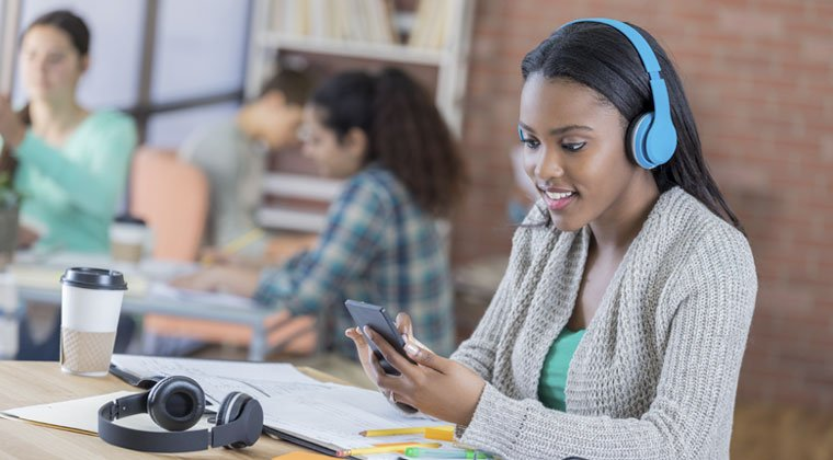 Student listening to music that helps support studying