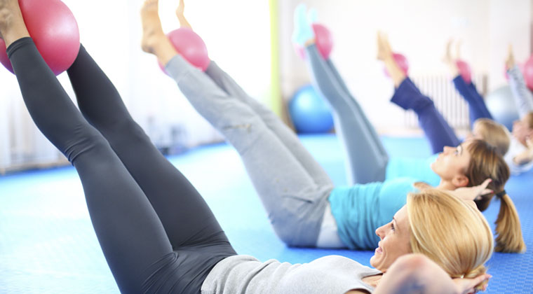 young women in pilates class for cellists