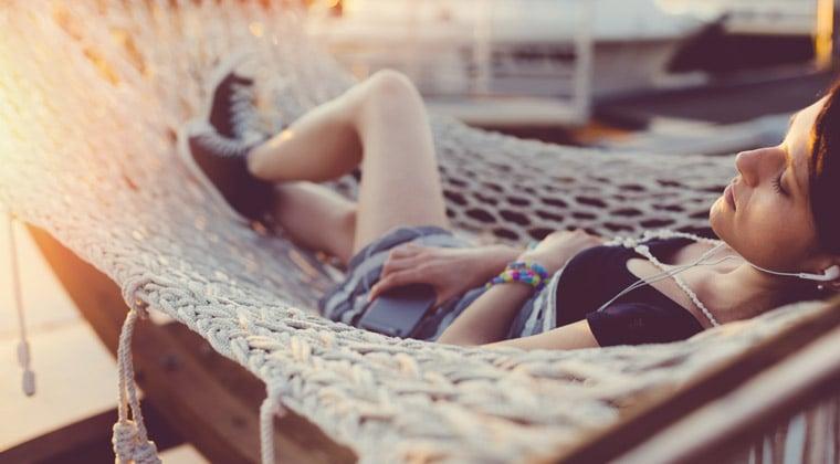 woman relaxing in hammock listening to mozart
