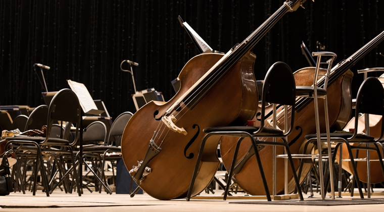 empty orchestra setup on stage, waiting for artistic director