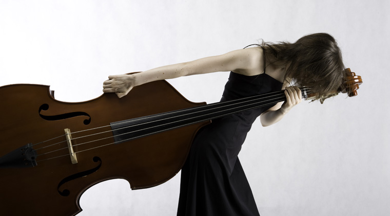 woman awkwardly carrying upright bass