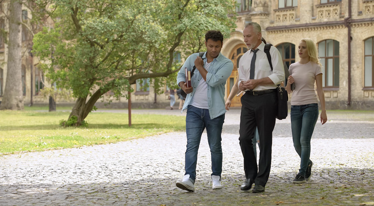 students walking with music professor to make a good impression