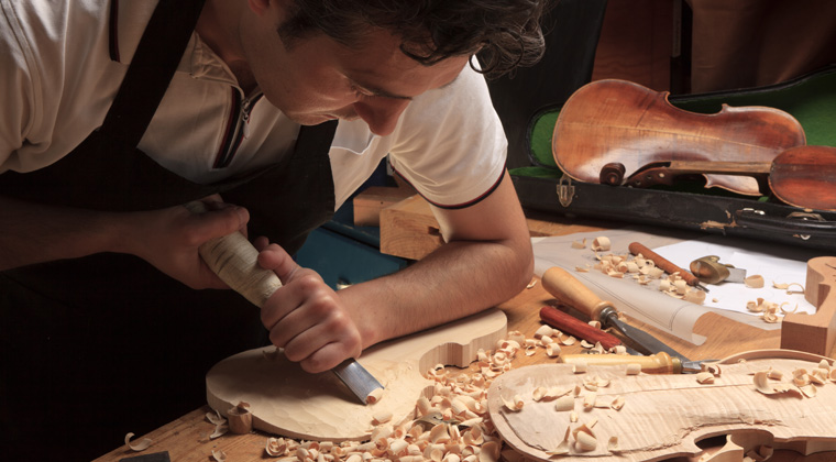 violin being carved by a luthier