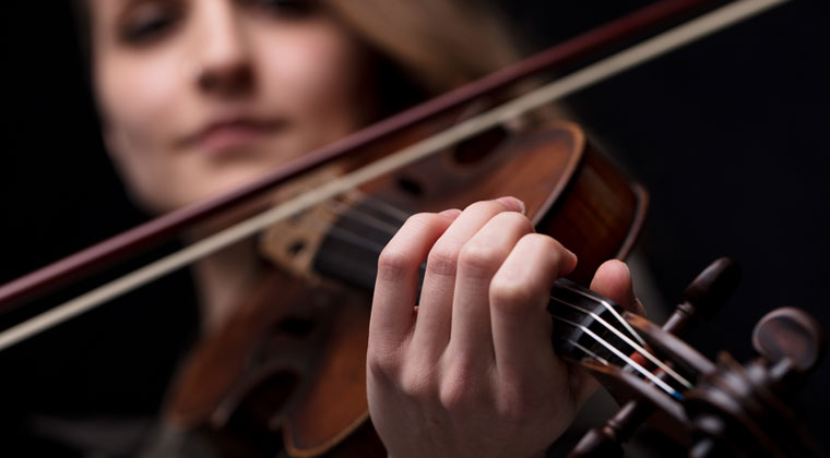 young women playing the fiddle
