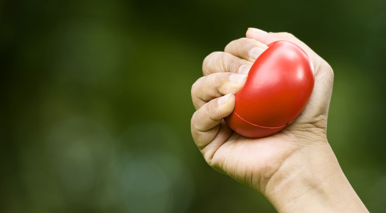 squeezing the stress ball for strength exercise violinist