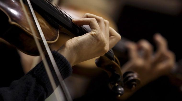 violinist practicing her finger dexterity