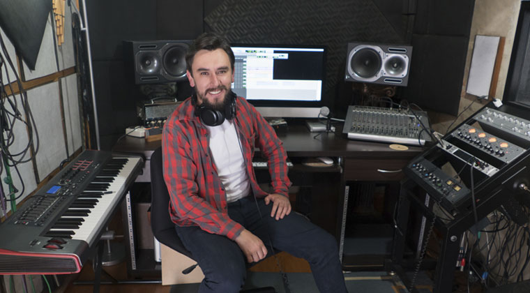 young man in the sound booth working as a musician