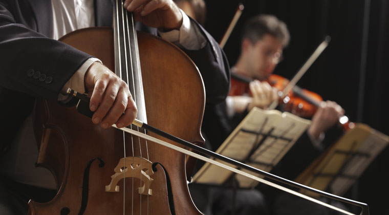 close up of string instruments in orchestra