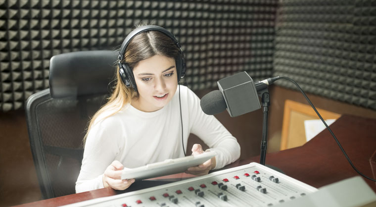 Young musician female working a summer job as a radio intern