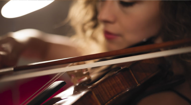 woman practicing violin