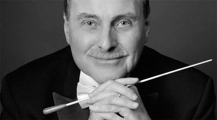 Headshot of conductor John Anderson as an example of a good publicity photograph for musicians