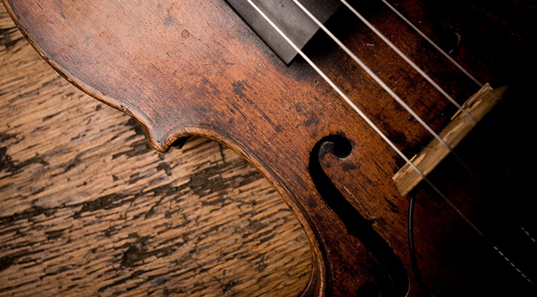 closeup of violin on a wood table