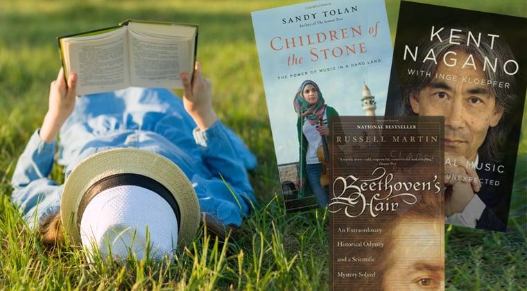Girl reading in field of grass