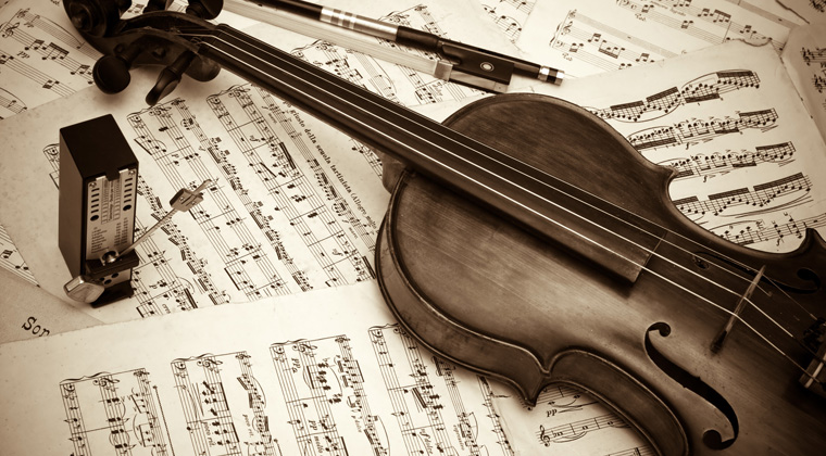 violin, metronome, sheet music and other must-have gear for string musicians