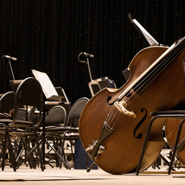 What is the Role of an Artistic Director with the Orchestra?