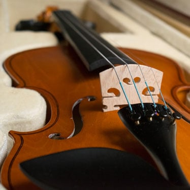 Why Do Gauge and Tension Matter for Violin Strings?